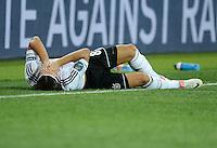 FUSSBALL  EUROPAMEISTERSCHAFT 2012   VORRUNDE Niederlande - Deutschland       13.06.2012 Mesut Oezil (Deutschland) verletzt am Boden