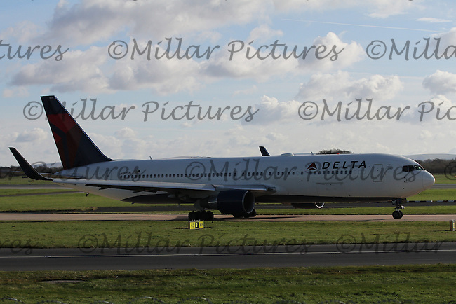 A Delta Air Lines Boeing 767-332(ER) Registration N197DN taxying at Manchester Airport on 14.2.16 bound for New York John F. Kennedy International Airport.