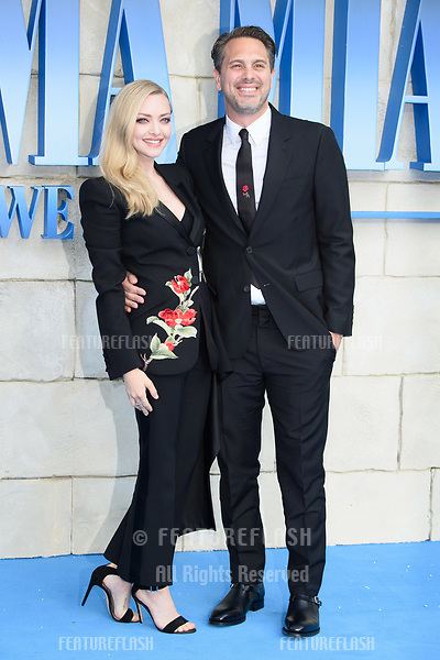"Amanda Seyfried & husband Thomas Sadoski arriving for the ""Mama Mia! Here We Go Again"" world premiere at the Eventim Apollo, Hammersmith, London, UK. <br /> 16 July  2018<br /> Picture: Steve Vas/Featureflash/SilverHub 0208 004 5359 sales@silverhubmedia.com"