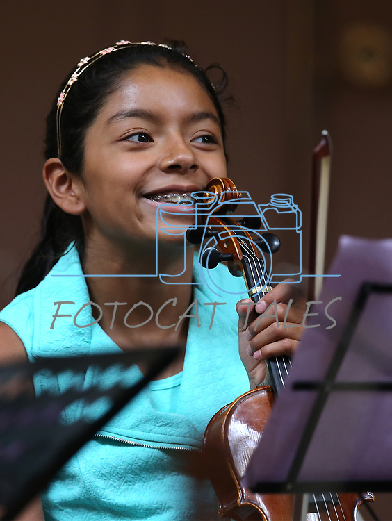 Alexandra Llamas-Cruz, 11, waits for the start of the Carson City Symphony's Youth Strings Summer Program concert in Carson City, Nev., on Thursday, July 27, 2017. <br /> Photo by Cathleen Allison