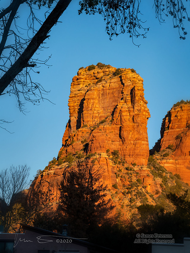 Morning Light on Castle Rock.  I'm not trying to make anyone jealous.  (Well, maybe just a little.)  But this is the kind of view we have to put up with from our neighborhood in Sedona, Arizona just about every morning.  In January.  Tough life, eh?<br /> <br /> Image ©2020 James D. Peterson