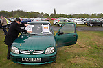 An away supporter promoting a charity match with posters on his car outside Key's Park prior to the Hednesford Town versus FC United of Manchester Northern Premier League premier division play-off final. The match would decide which club were promoted to the Blue Square Conference North. Hednesford won the game by 2 goals to 1 in front of a stadium record attendance of 4412 spectators.