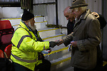 A club official giving out transfer tickets for the main stand at the Crabble before National League Dover Athletic hosted League 2 Cambridge United in an FA Cup first round replay. The club was founded in 1983 after the dissolution of the town's previous club Dover FC, whose place in the Southern League was taken by the new club. Cambridge United won the tie by 4-2 after extra time, watched by a crowd of 1158.