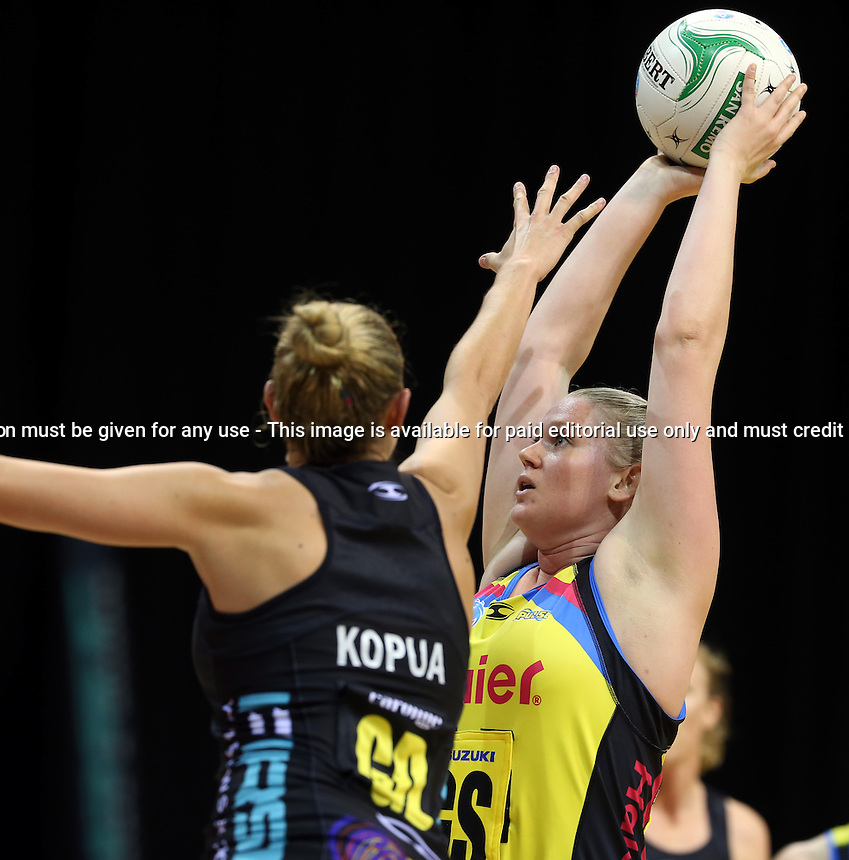13.05.2013 Magic'sCasey Kopua and Pulse's Caitlin Thwaites in action during the ANZ Champs netball match between the Magic and Pulse played at Claudelands Arena in Hamilton. Mandatory Photo Credit ©Michael Bradley.