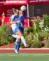 Chicago Red Stars defender Lauren Fowlkes (9) and Boston Breakers midfielder Leslie Osborne (12) compete for a head ball.The Boston Breakers beat the Chicago Red Stars 1-0 at Dilboy Stadium.
