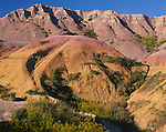 Badlands National Park, SD  <br /> Banded colors on eroded landforms and cliffs near Dillon Pass