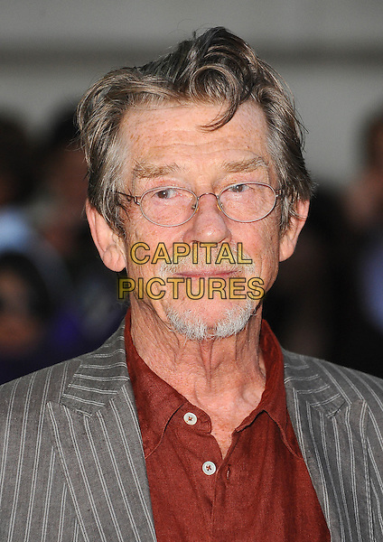 John Hurt.UK Premiere of 'Melancholia' at the Curzon, Mayfair, London, England..September 28th 2011.headshot portrait grey gray pinstripe suit jacket red shirt glasses goatee facial hair .CAP/BEL.©Tom Belcher/Capital Pictures.