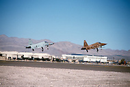 Nellis Air Force Base, Nevada - December 4, 1984. Pilots take off with a F-16C Fighting Falcon at the U.S. Air Force Tactical Fighter Weapons Center. The U.S. Air Force Tactical Fighter Weapons Center, later renamed the U.S. Air Force Warfare Center in 2005, was founded in 1966 and manages advanced pilot training, concentrating in development of weapons systems.