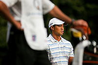 Golfer Tiger Woods examines the course during the Quail Hollow Championship golf tournament 2009. The event, formerly called the Wachovia Championship, is a top event on the PGA Tour, attracting such popular golf icons as Tiger Woods, Vijay Singh and Bubba Watson. Photo from the first round in the Quail Hollow Championship golf tournament at the Quail Hollow Club in Charlotte, N.C., Thursday, April 30, 2009.