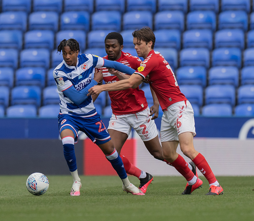 Reading's Michael Olise (left) under pressure from Middlesbrough's Anfernee Dijksteel (centre) and Middlesbrough's Jonathan Howson (right) <br /> <br /> Photographer David Horton/CameraSport<br /> <br /> The EFL Sky Bet Championship - Reading v Middlesbrough - Tuesday July 14th 2020 - Madejski Stadium - Reading<br /> <br /> World Copyright © 2020 CameraSport. All rights reserved. 43 Linden Ave. Countesthorpe. Leicester. England. LE8 5PG - Tel: +44 (0) 116 277 4147 - admin@camerasport.com - www.camerasport.com