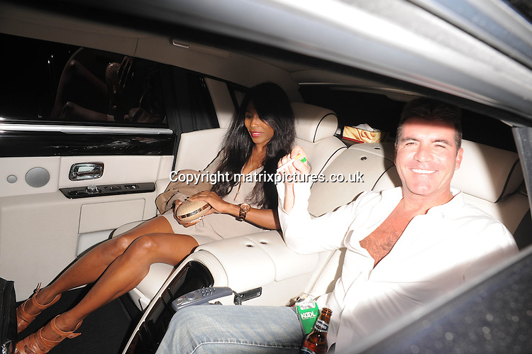 NON EXCLUSIVE PICTURE: PALACE LEE / MATRIXPICTURES.CO.UK<br /> PLEASE CREDIT ALL USES<br /> <br /> WORLD RIGHTS<br /> <br /> British television producer Simon Cowell and British-American singer, Sinitta are pictured after the Britain's Got Talent live final show, in London.<br /> <br /> Natalie Holt, a former contestant on the show, threw eggs at Simon Cowell during the live final of Britain's Got Talent. The police were called, however no further action will be taken.<br /> <br /> JUNE 8th 2013<br /> <br /> REF: LTN 133934