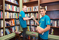 Bridget Hayden,'21, and Thor Brochu,'21, scan and organize books at the Redwood Library as they participate in the Salve Regina University Exploration Day of Service in Newport.