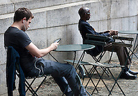A reader uses his Amazon Kindle electronic book in Bryant Park in New York on Thursday, June 7, 2012 (© Richard B. Levine)