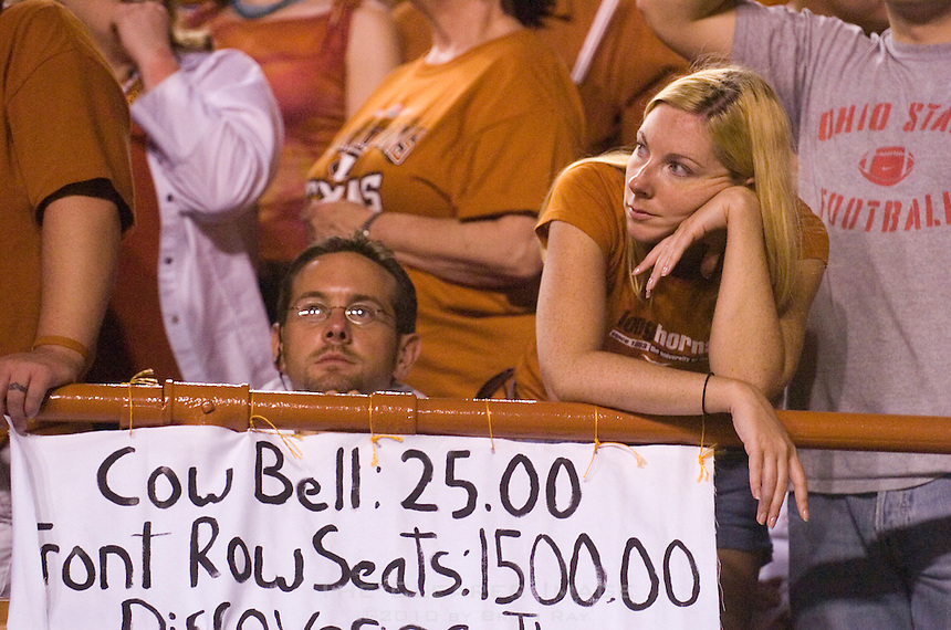 09 September 2006: University of Texas alum Ryan Miller (right) stands behind her homemade sign as she watches the Longhorns chances dwindle during her team's 24-7 loss to the Ohio State Buckeyes at Darrell K Royal Memorial Stadium in Austin, TX.