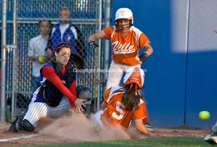 WEST HAVEN, CT - 08 JUNE 2010 -060810JT05-<br /> Terryville's Marissa Pilkus scores a run just after teammate Devan Embleton, background, after Coginchaug catcher Mallorie Dorflinger missed a throw during Tuesday's Class S semifinal game at West Haven. Terryville won, 2-0.<br /> Josalee Thrift Republican-American