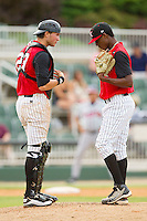 Kannapolis Intimidators catcher Michael Marjama (23) has a chat with starting pitcher Euclides Leyer (26) during the South Atlantic League game against the Rome Braves at CMC-Northeast Stadium on August 5, 2012 in Kannapolis, North Carolina.  The Intimidators defeated the Braves 9-1.  (Brian Westerholt/Four Seam Images)