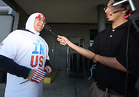 DC young greeter Hidayah Jaka is interviewed by the press during the arrival of the FIFA World Cup 2018-2022 inspection delegation to Washington D.C. at Dulles International Airport.