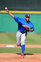 Dominican Republic pitcher Alfredo Simon #31 during a Spring Training game against the Philadelphia Phillies at Bright House Field on March 5, 2013 in Clearwater, Florida.  The Dominican defeated Philadelphia 15-2.  (Mike Janes/Four Seam Images)