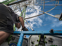 NWA Democrat-Gazette/ANTHONY REYES &bull; @NWATONYR<br /> James Carney, with Pride Amusements of Joplin, assembles the seats for the ferris wheel Monday, Sept. 28, 2015 with a crew for the Fall Carnival at Parsons Stadium in Springdale. Preperations for the carnival included setting up the rides, games and other boothes. The carnival begins Wednesday at 6 p.m. and continues until Oct. 4.