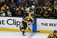 June 6, 2019: Boston Bruins defenseman Torey Krug (47) checks St. Louis Blues left wing Zach Sanford (12) into the bench area during game 5 of the NHL Stanley Cup Finals between the St Louis Blues and the Boston Bruins held at TD Garden, in Boston, Mass. The Blues defeat the Bruins 2-1 in regulation time. Eric Canha/CSM