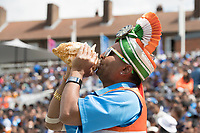 A supporter blows into a conch as India hit a boundary during India vs New Zealand, ICC World Cup Warm-Up Match Cricket at the Kia Oval on 25th May 2019