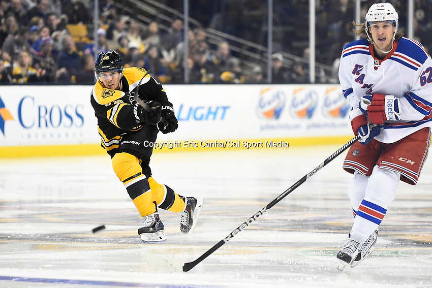 January 15, 2015 - Boston, Massachusetts, U.S. - Boston Bruins center David Krejci (46) fires the puck out of the neutral zone during the NHL match between the New York Rangers and the Boston Bruins held at TD Garden in Boston Massachusetts. The Bruins defeated the Rangers 3-0 in regulation time. Eric Canha/CSM