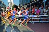 25 JUN 2011 - PONTEVEDRA, ESP - Brothers Alistair Brownlee (GBR) and Jonathan Brownlee (GBR) run past the crowds during the first lap of the run at the Elite Men's European Triathlon Championships in Pontevedra, Spain (PHOTO (C) NIGEL FARROW)