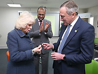 05/02/2020 - Camilla Duchess of Cornwall receives a badge to mark more than 10 years of service to Bernardo's from chair of trustees John Bartlett (right) and chief executive Javed Khan during a visit to Barnardo's Child and Sexual Abuse and Exploitation Services in north London. Photo Credit: ALPR/AdMedia
