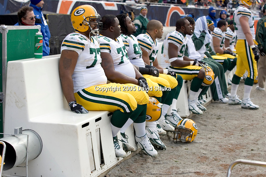 CHICAGO - DECEMBER 4: The defense of the Green Bay Packers rest on the heated benches during the game against the Chicago Bears on December 4, 2005 at Soldier Field in Chicago, Illinois. The Bears defeated the Packers 19-7. (Photo by David Stluka)