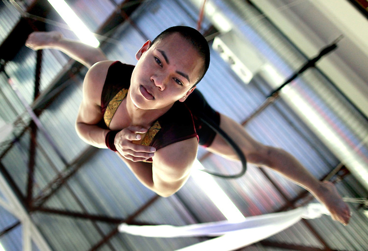"Mo-Nika Ell, a 2008 ACMA grad, rehearses his routine on the aerial bars last Sunday for Pendulum Dance Theatre's production ""NINE: An Evening of Unconfined Circus"" which is being held May 2nd and 3rd at the French American International School."
