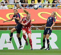 Aly Wagner, Heather Mitts, Amber Allen. The USWNT defeated Canada, 1-0, at Suwon World Cup Stadium in Suwon, South Korea, to win the Peace Queen Cup.