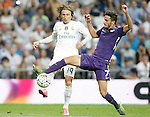 Real Madrid's Luka Modric (l) and Malaga's Juan Carlos Perez during La Liga match. September 26,2015. (ALTERPHOTOS/Acero)