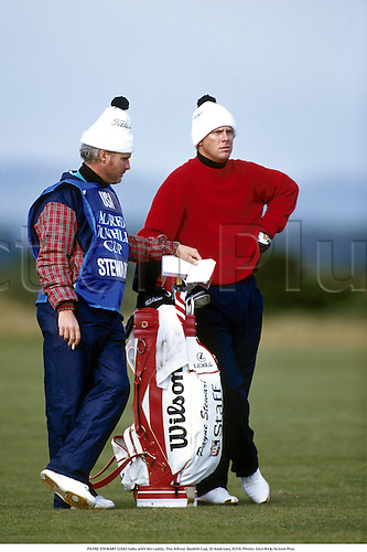 PAYNE STEWART (USA) talks with his caddie, The Alfred  Dunhill Cup, St Andrews, 9310. Photo: Glyn Kirk/Action Plus....1993.golf.bobble hat.golf bag.golfer golfers
