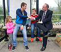 First Minister Alex Salmond stops off for a chat with Engineer Ryan Webster, 27, and his kids Daryl, nine, and five-year-old Kaitlyn.at a bus stop whilst on the campaign trail in Ellon.