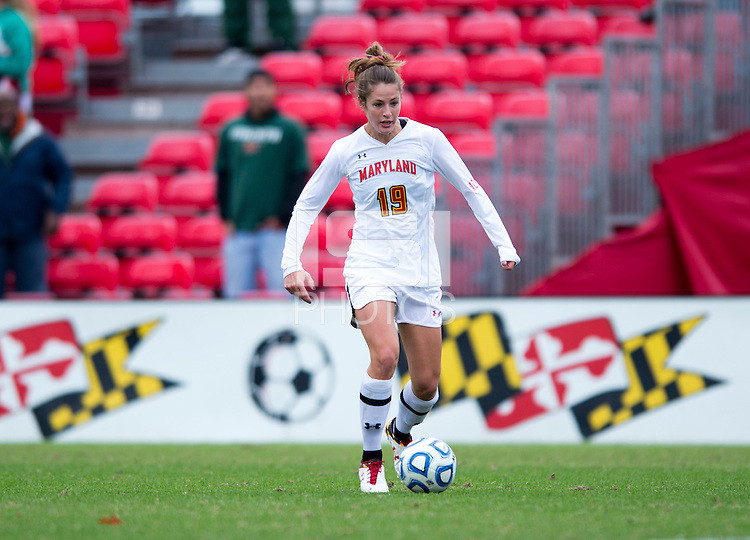 Becky Kaplan (19) of Maryland  brings the ball forward during the game at Ludwig Field in College Park, MD.  Maryland defeated Miami, 2-1, in overtime.