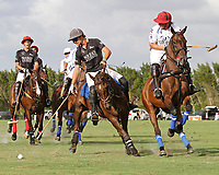 WELLINGTON, FL - APRIL 15:  Jared Zenni of Palm Beach Illustrated (dark jersey) controls the ball along the sideline of the $100,000 World Cup Final, at the Grand Champions Polo Club, on April 15, 2017 in Wellington, Florida. (Photo by Liz Lamont/Eclipse Sportswire/Getty Images)