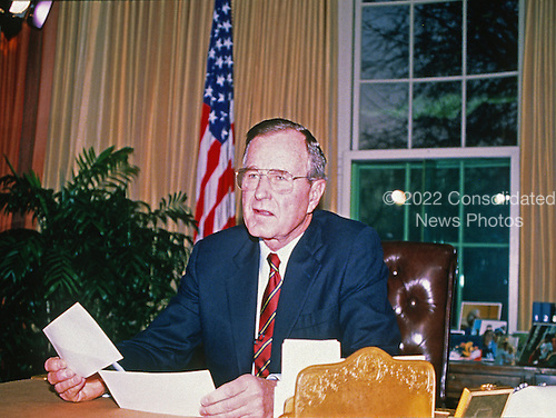 United States President George H.W. Bush addresses the nation from the Oval Office of the White House in Washington, D.C. concerning the U.S. invasion of Panama on December 20, 1989.  The action resulted in the removal of General Manuel Noriega from the leadership of Panama.<br /> Credit: Ron Sachs / CNP