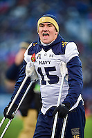 Baltimore, MD - DEC 10, 2016: Injured Midshipmen quarterback Will Worth (15) argues with a Army fan before halftime of the game between Army and Navy at M&T Bank Stadium, Baltimore, MD. (Photo by Phil Peters/Media Images International)