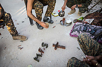 August 2017. Raqqa, Syria.<br /> Members of the MFS drink tea and kill time on the front lines.<br /> The MFS (Syriac Military Council) are a group of Assyrian Christians who fight alongside the Syrian Democratic Forces in the fight to topple ISIS.<br /> Photographer: Rick Findler