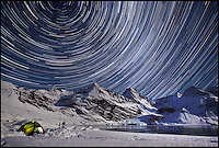 BNPS.co.uk (01202 558833).Pic: SamanthaCrimmin/BNPS..***Please Use Full Byline***..Star trails above the Harker Glacier in South Georgia...A British Doctors braved freezing conditions to capture unique pictures of the night sky from the tiny British island of South Georgia in the remote South Atlantic...Amateur photographer Samantha Crimmin's stunning photos of the sky at night over South Georgia have left locals so star-struck they have been turned into stamps...Dr Samantha Crimmin was working as an emergency medic for the British Antartic Survey team when she took the celestial images in her spare time...Dr Crimmin used long exposures and plenty of patience to create the incredible shots that show star trails in a perfect circular motion...Her gallery of photos depict the night sky above different locations on the tiny outpost in the south Atlantic...They include one above the Harker Glacier - named after British geologist Alfred Harker - and over the wrecks of two Norwegian whaling ships at Grytviken.