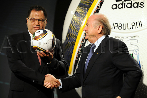 FIFA President Joseph Blatter (R) hands Jabulani, the official ball for the FIFA 2010 World Cup South Africa, to Danny Jordaan (L), managing director of the organisation committee, in Cape Town, South Africa, 04 December 2009. Jabulani is produced by German company adidas. Photo: BERND WEISSBROD/actionplus. UK Licenses Only.