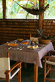 Tataquara, Amazon, Brazil. Ecotourism tourist lodge hotel; table in restaurant set for breakfast; Tataquara, Xingu river.