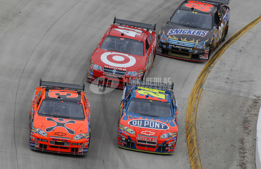 Apr 1, 2007; Martinsville, VA, USA; Nascar Nextel Cup Series drivers Jeff Burton (31) Jeff Gordon (24) Reed Sorenson (41) and Ricky Rudd (88) race during the Goody's Cool Orange 500 at Martinsville Speedway. Martinsville marks the second race for the new car of tomorrow. Mandatory Credit: Mark J. Rebilas