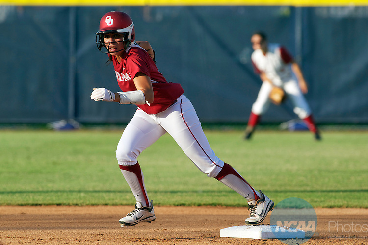 04 JUNE 2012:   Destinee Martinez (00) of the University of Oklahoma prepares to take off from 2nd base against the University of Alabama during the Division I Women's Softball Championship held at ASA Hall of Fame Stadium in Oklahoma City, OK.  Oklahoma defeated Alabama 4-1 in Game One of the National Championship.   Shane Bevel/NCAA Photos