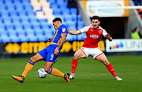 Lewis Coyle of Fleetwood Town battles for the ball against Ben Godfrey of Shrewsbury Town during the Sky Bet League 1 match between Shrewsbury Town and Fleetwood Town at Greenhous Meadow, Shrewsbury, England on 21 October 2017. Photo by Leila Coker / PRiME Media Images.