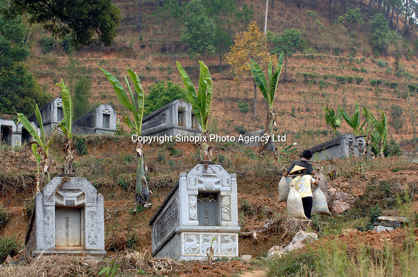 Banlao cemetry is littered with large graves that mostly belong to men in Banlao village in Yongde County near the China-Burmese border in western Yunnan. Half of the males in this area have been executed from drug smuggling. The area is famed for the number of desperately poor people that make a living by smuggling heroin from Burma into China. ..PHOTO BY SINOPIX