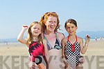 Roise Gavin, Orla and Christina Kaiser enjoying the sunshine at Banna beach on Tuesday.
