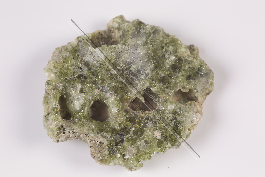 Trinitite, also known as atomsite or Alamogordo glass, is the glassy residue left on the desert floor after the plutonium-based Trinity nuclear bomb test on July 16, 1945, near Alamogordo, New Mexico. The glass is primarily composed of arkosic sand composed of quartz grains and feldspar that was melted by the atomic blast. Trinitite is mildly radioactive but is safe to handle for short periods of time.