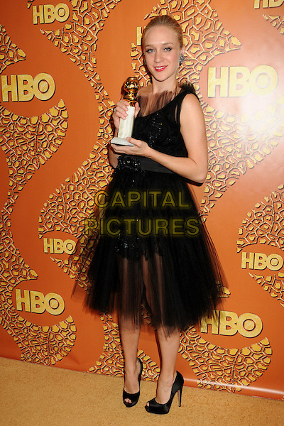 CHLOE SEVIGNY.HBO's 2010 67th Golden Globe Awards Post Party held at the Beverly Hilton Hotel, Beverly Hills, California, USA. .January 17th, 2009 .globes full length black sleeveless dress sparkly tulle award trophy shoes chiffon .CAP/ADM/BP.©Byron Purvis/Admedia/Capital Pictures