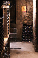 old bottles in the cellar domaine chevalier p&f ladoix cote de beaune burgundy france